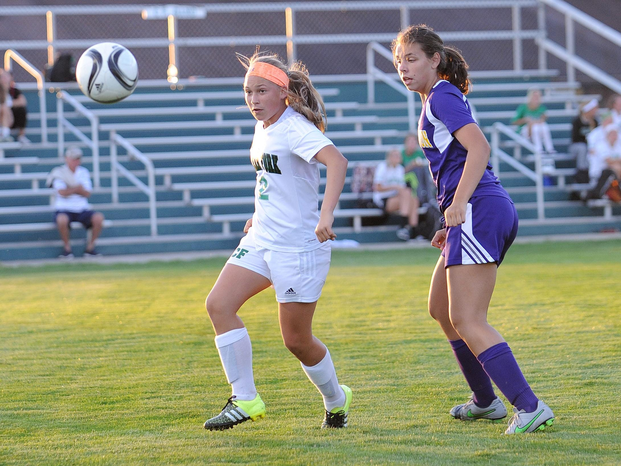 Clear Fork's Kaylin Helinski battles for control over the ball Tuesday evening during their game against Lexington.