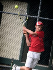 Ben Clary rips a backhand return during Thursday night's Mt. Gretna singles final.