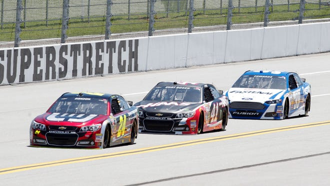 NASCAR Sprint Cup Series driver Jeff Gordon (24) , Kurt Busch (41) and Carl Edwards (99) during qualifying for the Aaron's 499 at Talladega Superspeedway.