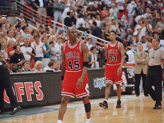 Chicago Bulls guard Michael Jordan (45) and forward Scottie Pippen (33) walk back to the bench during a timeout with 1.5 seconds left and the Orlando Magic leading 94-91 during their first  playoff game in Orlando, May 7, 1995. The Magic won by the same score. (AP Photo/Robert Baker)