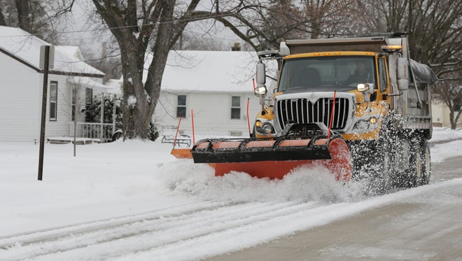 An Oshkosh city snowplow clears a street in this 2016 file photo.