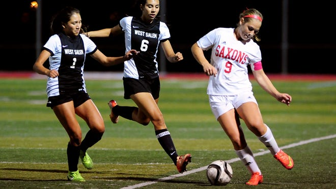South Salem midfielder Lindsay Flood (9) with the ball while West Salem's Liz Mendez (1) and Kaitlin Poe (6) apply pressure during a Greater Valley Conference game, Wednesday, Oct. 6, 2015, in Salem, Ore.