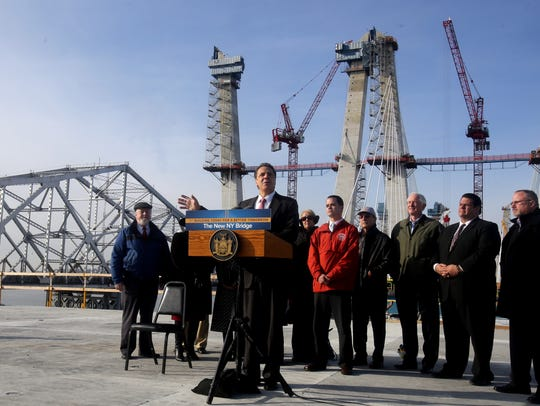 Gov. Andrew Cuomo speaks as he and other officials