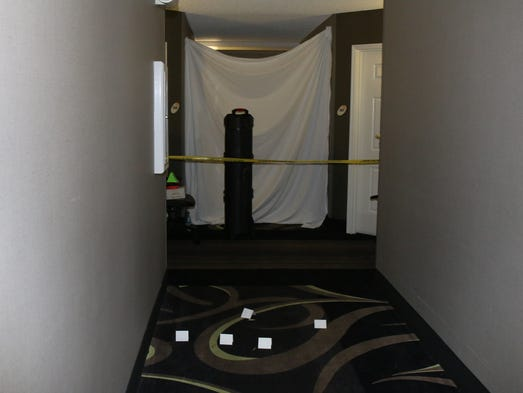 The fifth-floor hallway of a Mesa hotel where an unarmed