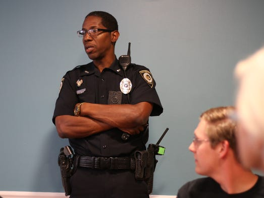 Officer Joel Witherspoon talks to students and community