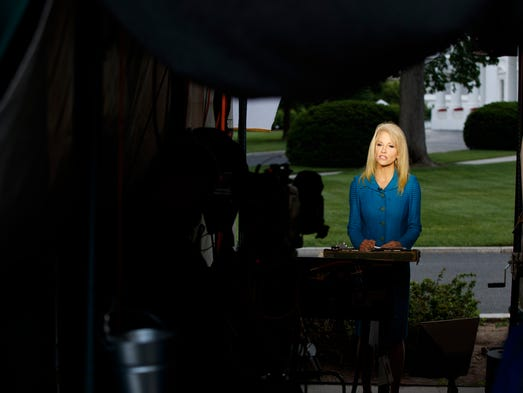 Conway speaks during an interview outside the White