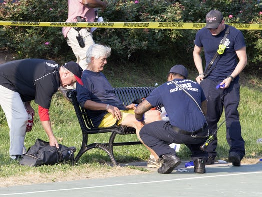 A man receives medical attention from first responders