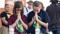 Authorities on Saturday allowed small groups of students back inside the Texas high school here to gather their belongings the day after they were forced to flee for their lives as a gunman carried out a deadly school shooting.
