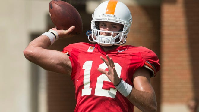 Vols quarterback Quinten Dormady (12) throws a ball during practice on Tuesday, Aug. 15, 2017.