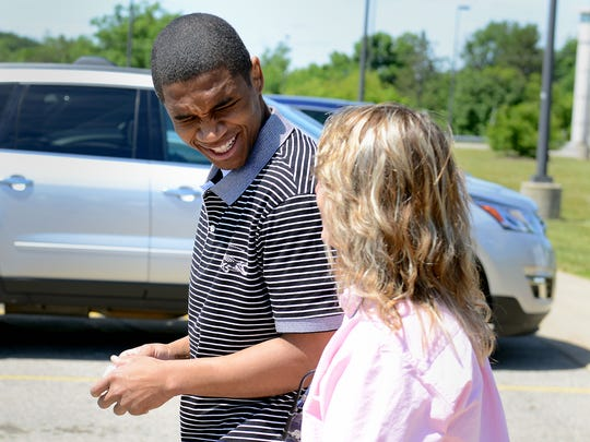Attorney Valerie Newman, then with the Michigan State Appellate Defender Office, walks out of a state prison with Davonte Sanford, then 23, in June  2016, after she helped exonerate him of a quadruple drug house murder. Newman will head the newly formed conviction integrity unit  in the Wayne County Prosecutor's Office.