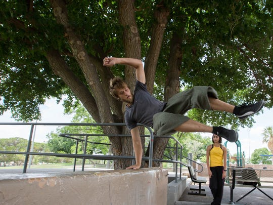 Joseph Lanning, a certified parkour instructor in Las Cruces, shows off a few of his skills on a wall at Young Park.