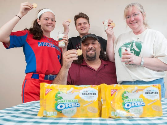 Dave Magpiong of Bellmawr, center, a teacher at Voorhees Middle School, is a finalist in the #MyOreoCreation contest after entering with the idea of a pina colada-flavored cookie.  Dave and his family, from left, daughter Amanda, son Mark, and wife Jean display the Oreo Pina Colada Thins.