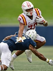 Iowa State Cyclones running back David Montgomery (32) is tackled by Akron Zips defensive back Kyron Brown in the fourth quarter at InfoCision Stadium in Akron, Ohio.