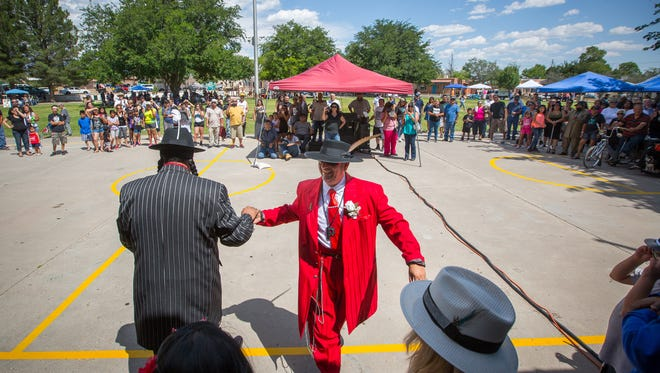 "Cisco Martinez, right, shakes the hand of Victor Guzman after performing for the crowd during the zoot suit contest at the first Zoot Suit Pachanga in Klein Park, June 4, 2016. The pachanga, which in Spanish is defined as a party or ""bash"", was organized to celebrate the culture of the Mesquite Historic District."