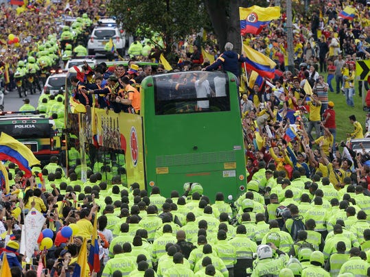 Members of Colombia's national soccer team are welcomed home from the World Cup, in Bogota, Colombia, Sunday, July 6, 2014. Thousands of fans turned out for the Sunday homecoming of superstar James Rodriguez, his teammates and coach Jose Pekerman following their 2-1 loss to Brazil in the quarterfinals on Friday. (AP Photo/Fernando Vergara)