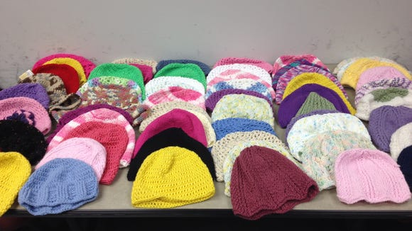Here are 60 of the 75 hats that readers turned in yesterday at the Courier News/Home News Tribune office.