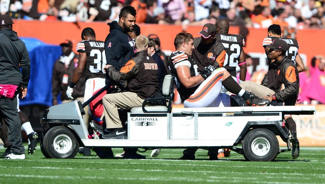 Cleveland Browns center Alex Mack (55) is carted off the field after an injury during the second quarter against the Pittsburgh Steelers at FirstEnergy Stadium.