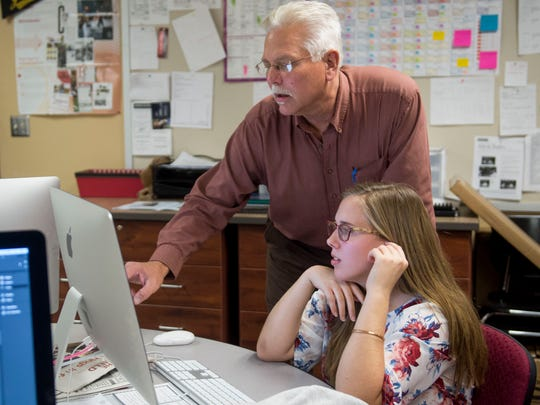 Don Asay, Gibson Southern High School English teacher, newspaper and yearbook sponsor, helps Paige Johnson with her page during newspaper class at Gibson Southern High School in Fort Branch, Ind., on Wednesday, Nov. 15, 2017.