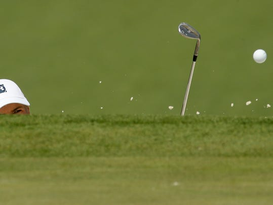 Jordan Spieth hits out of the bunker on the seventh hole during practice for the Masters golf tournament at Augusta National Golf Club, Tuesday, April 3, 2018, in Augusta, Ga. (AP Photo/Charlie Riedel)