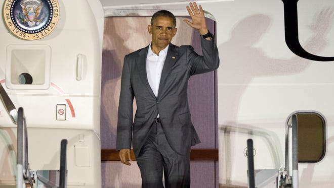 President Barack Obama has granted commutations and pardons to a handful of Treasure Coast residents while in office. Here, he steps out of Air Force One on June 3, 2016, after arriving at the Treasure Coast International Airport and Business Park in St. Lucie County.