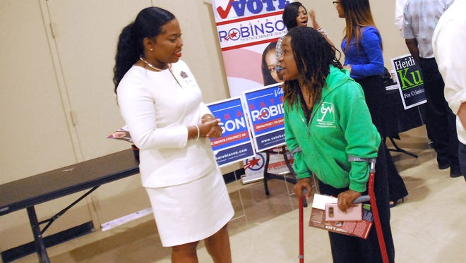 July 9, 2018 - Katrina Robinson (left) meets with voters during a recent election meet and greet at Abundant Grace Fellowship.(Stan Carroll/For the Commercial Appeal)