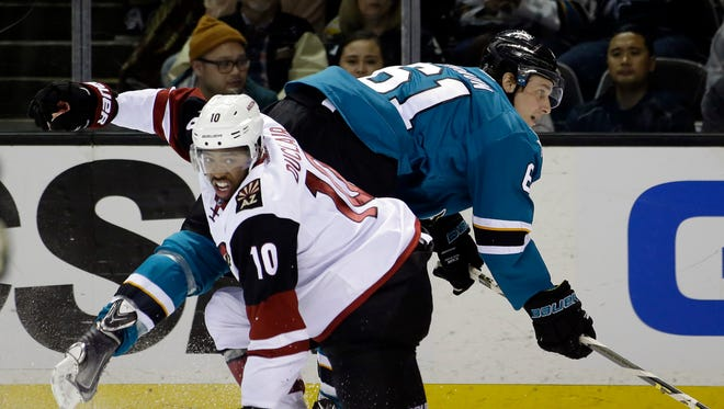 Arizona Coyotes' Anthony Duclair (10) collides with San Jose Sharks' Justin Braun (61) during the second period of an NHL hockey game Saturday, Feb. 13, 2016, in San Jose, Calif.
