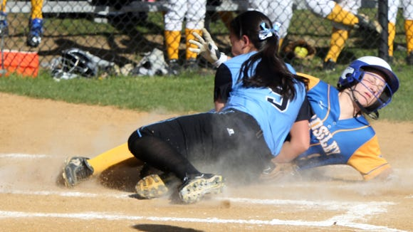 Rye Neck's Olivia Dunn fails to tag Ardsley's Lauren Rende (9) out at home plate during girls softball game at Ardsley High School on April 18, 2016.  Ardsley defeated Rye Neck 19-4.