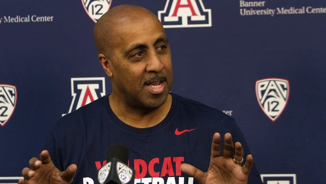 New Arizona associate head coach Lorenzo Romar answers questions during a news conference Thursday in Tucson.