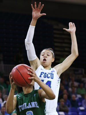 FGCU's Whitney Knight defends against Tulane on Wednesday at Alico Arena in Fort Myers. FGCU beat Tulane 73-61 to advance to the Elite Eight of the WNIT tournament.