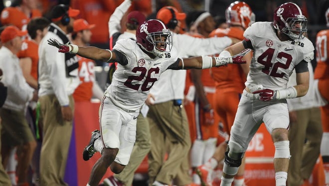 Alabama Crimson Tide defensive back Marlon Humphrey (26) celebrates after recovering an onside kick during the fourth quarter against the Clemson Tigers in the 2016 CFP National Championship at University of Phoenix Stadium.