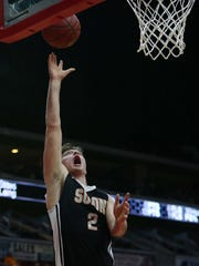 Solons' Jacon Coons shoots the ball during the Solon vs. Chariton 3A first round game of the Iowa High School Boy's Basketball Championship on Tuesday, March 8, 2016, in Wells Fargo Arena.