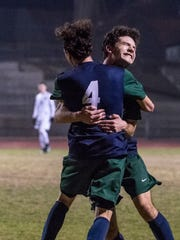 El Diamante's Andrew Garcia, left, and Dakotah Ybarra celebrate Ybarra's goal that put them up 3-0 against Redwood in a West Yosemite League high school boys soccer match on Wednesday, January 31, 2018. Garcia scored the first goal and Jacob Perez scored the second.