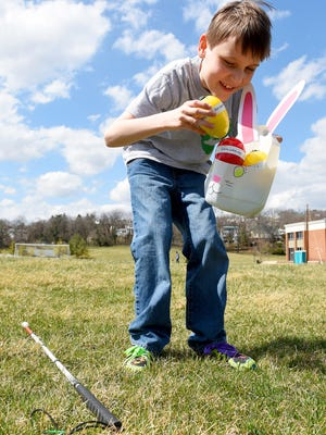 Visually impaired, Noah King, 10, adds another beeping Easter egg to his basket. Beeping eggs were hidden for students in the deaf department find at the Virginia School for the Deaf and the Blind on Thursday, March 26, 2015.