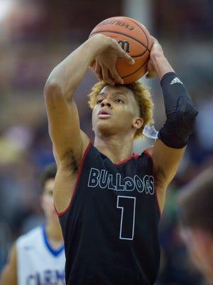 New Albany High School senior Romeo Langford (1) shoots a free throw during the second half an IHSAA varsity basketball game at Carmel High School, Saturday, December 16, 2017. New Albany won 59-48.