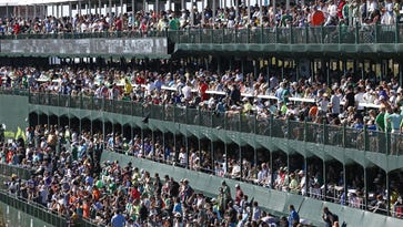 Spectators pack the staduim seats at the 16th hole, 201,003 spectators set a new record attendance during the third round of the Waste Management Phoenix Open golf tournament at TPC Scottsdale in Scottsdale, Ariz., on Saturday, February 6, 2016.