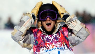 In a file photo of Feb 8, 2014, Sage Kotsenburg  reacts during men's slopestyle finals at the Sochi Winter Games at Rosa Khutor Extreme Park.