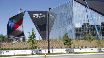 In this June 2, 2016, file photo, finishing touches are made on U.S. Bank Stadium, the new home of the Minnesota Vikings National Football League football team in Minneapolis.