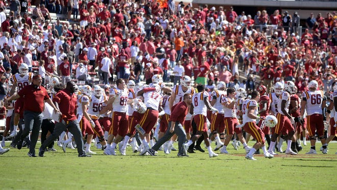 Oct 7, 2017; Norman, OK, USA; The Iowa State Cyclones celebrate after defeating the Oklahoma Sooners at Gaylord Family - Oklahoma Memorial Stadium. Mandatory Credit: Mark D. Smith-USA TODAY Sports