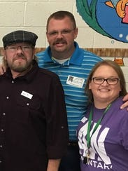 Nick Long, center, and his wife Carissa, were longtime