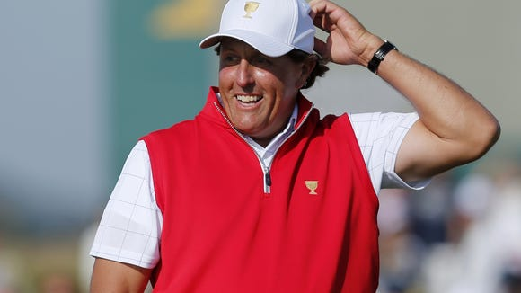 File-This Oct. 8, 2015, file photo shows United States' Phil Mickelson reacting to his putt on the 17th green during his foursome match at the Presidents Cup golf tournament at the Jack Nicklaus Golf Club Korea, in Incheon, South Korea. Mickelson  was a captain's pick to be play in the Presidents Cup later this month at Liberty National. (AP Photo/Woohae Cho, File)