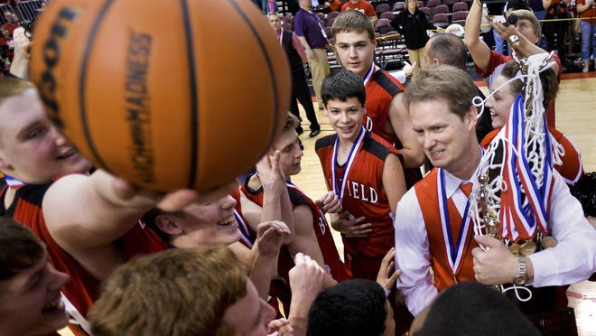 Brimfield coach Scott Carlson celebrates with his team after winning the 2015 Class 1A boys basketball state championship at Carver Arena in Peoria.