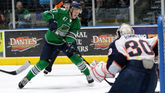 Logan Roe gets a look at goal during the Florida Everblades final regular season home series against the Greenville Swamp Rabbits at Germain Arena on Friday, March 30, 2018. The Blades defeated the Swamp Rabbits, 5-3, and move to 48-13,-2-4 on the season.