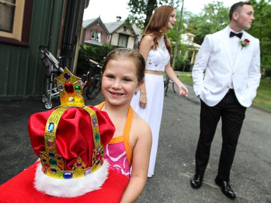 Brenna Witting, 7, waits for the start of the crowning of the new king and queen for the 147th annual Children's Day Weekend.