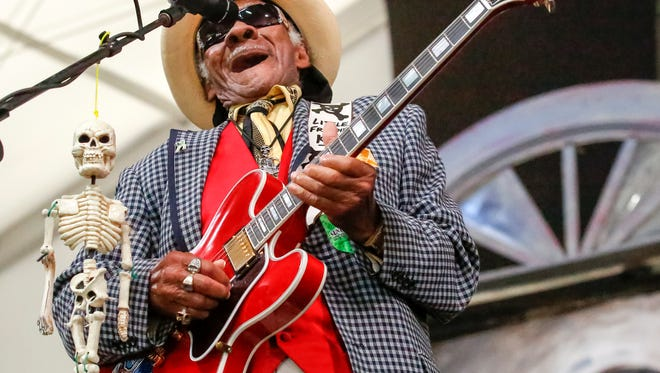 Little Freddie King performs during the New Orleans Jazz & Heritage Festival, Sunday, April 24, 2016, in New Orleans.