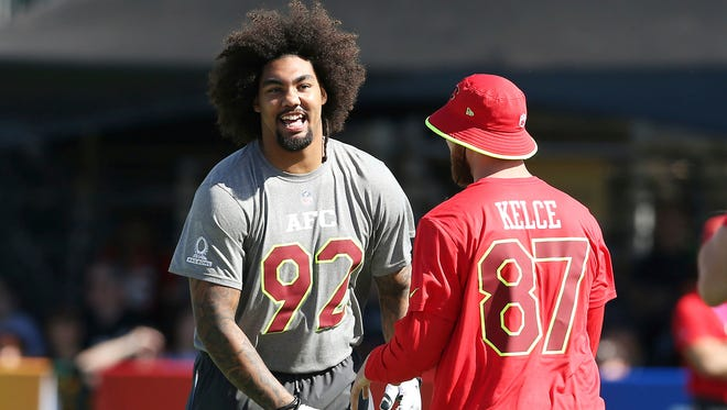 New York Jets defensive end Leonard Williams (92) laughs with Kansas City Chiefs tight end Travis Kelce (87) during the AFC practice for the NFL Pro Bowl, Wednesday, Jan. 25, 2017 in Lake Buena Vista, Fla. (AP Photo/Doug Benc)