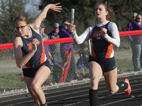 Galion's Marisa Gwinner , winner in the high jump and long jump, hands off the baton to Kerrigan Myers in the 4x100 during Friday's Marion Night Invitational.
