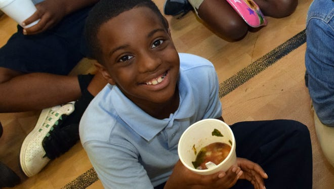 Jarvis Russell, a third-grader at Mabel Brasher Elementary School, likes the cabbage soup made from vegetables growing in the garden at his schools.