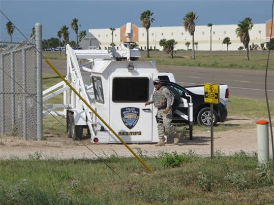 A Texas National Guardsman exits an observation tower in Hidalgo, Texas, on Thursday, Aug. 14, 2014. Several dozen soldiers deployed in the Rio Grande Valley are part of the up to 1,000 troops called up by Gov. Rick Perry last month, Texas National Guard Master Sgt. Ken Walker of the Joint Counterdrug Task Force said Thursday. (AP Photo/Christopher Sherman)