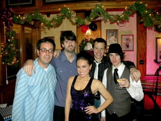 Just Like Prom Night, shown here at their New Year s Eve gig at Roosevelt Tavern, plays a mix of tunes from  80s artists including Boy George, Man At Work and Roxette.