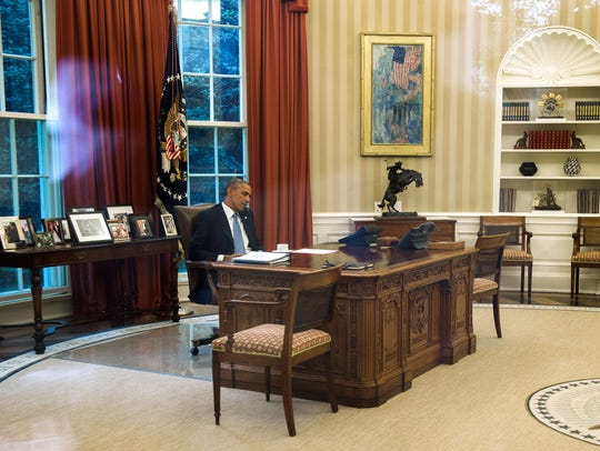 President Barack Obama talks on the phone with King